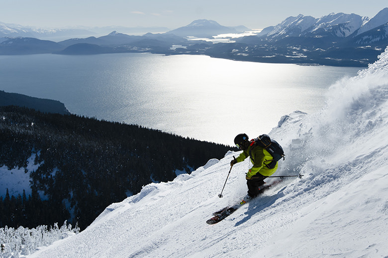 Ryan van den meerendonk skiing above the oceans of Juneau alaska at eagle crest ski area